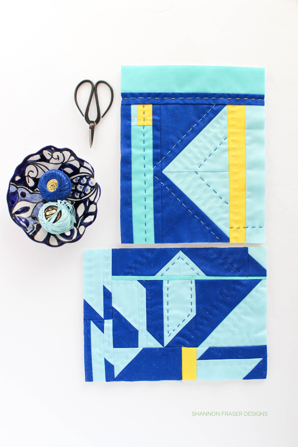 Blue and yellow modern mini abstract improv quilts featuring fabric scraps and hand quilted with pearl cotton thread | Shannon Fraser Designs #sustainablequilting #noscapwasted #fiberart #miniquilt