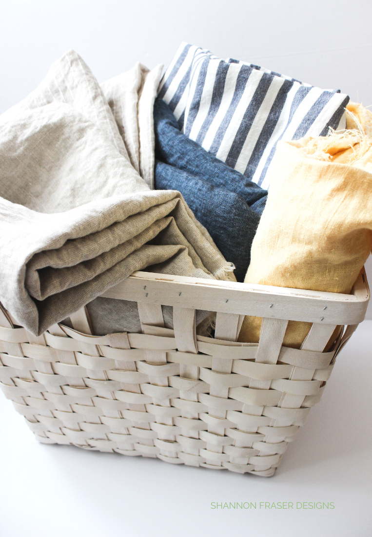 White basket filled with laundered linen | Shattered Star QAL: Week 2 - Part 1 how to press your fabric | Shannon Fraser Designs #linen
