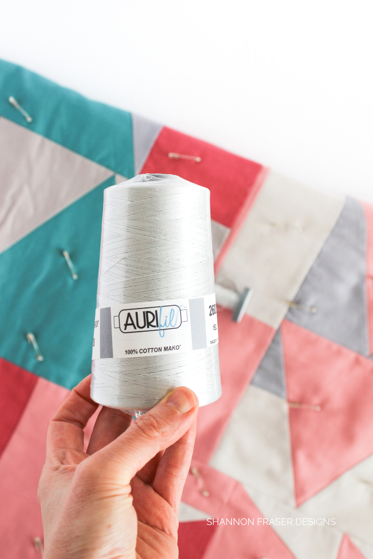 Aurifil Thread 28wt cone in the color Dove over improv quilt | Shannon Fraser Designs