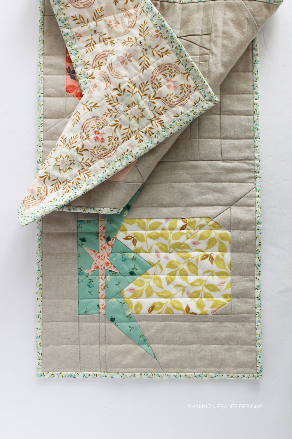 A peek at the backing on the Jolly Jelly x AGF Velvet quilted table runner by Shannon Fraser Designs #quiltedtablerunner