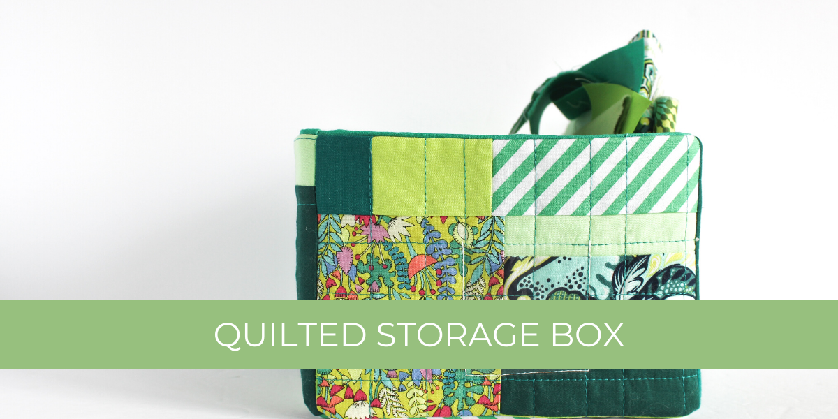 green improv quilted storage box with fabric scraps