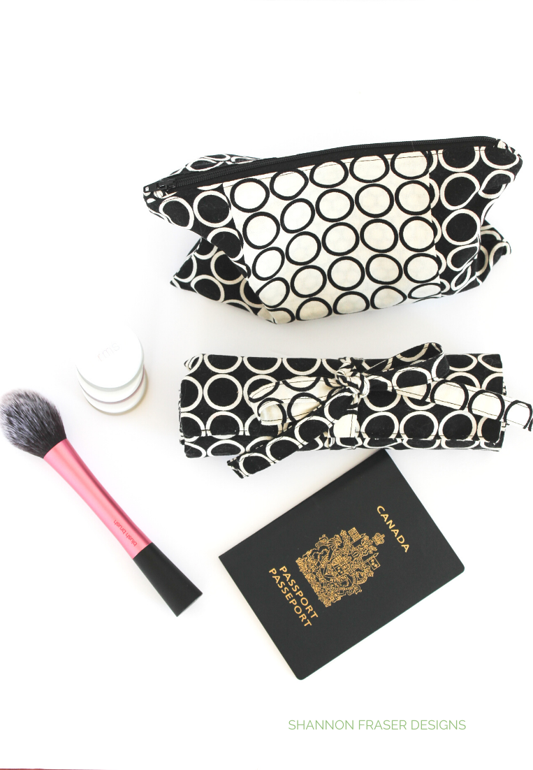 Black & white make-up bag with make-up and brush and Canadian passport | Shannon Fraser Designs