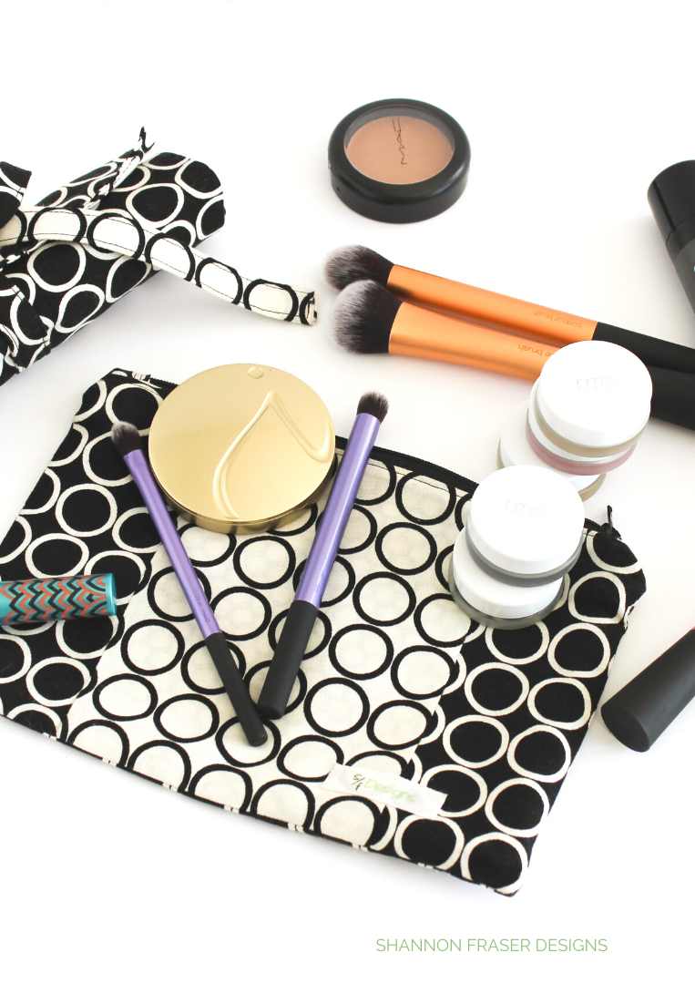Black and white make-up bag with makeup and brushes scattered | Shannon Fraser Designs