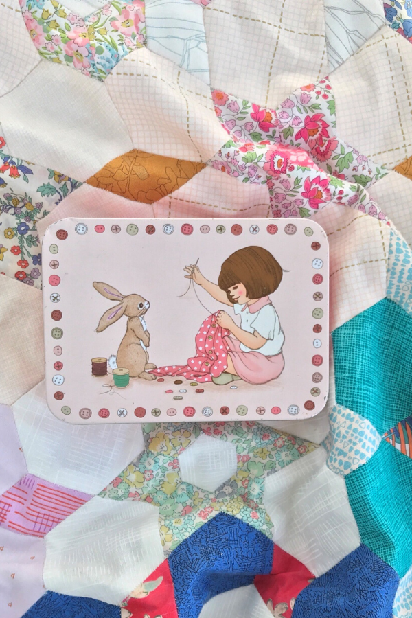 Ange's Belle & Boo EPP sewing kit sitting on top of her English Paper Pieced quilt
