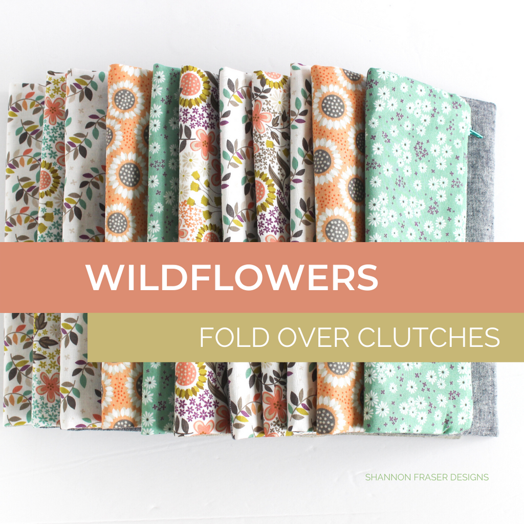 Colorful stack of fold over clutches featuring Wildflowers fabric collection from Camelot Fabrics | Shannon Fraser Designs