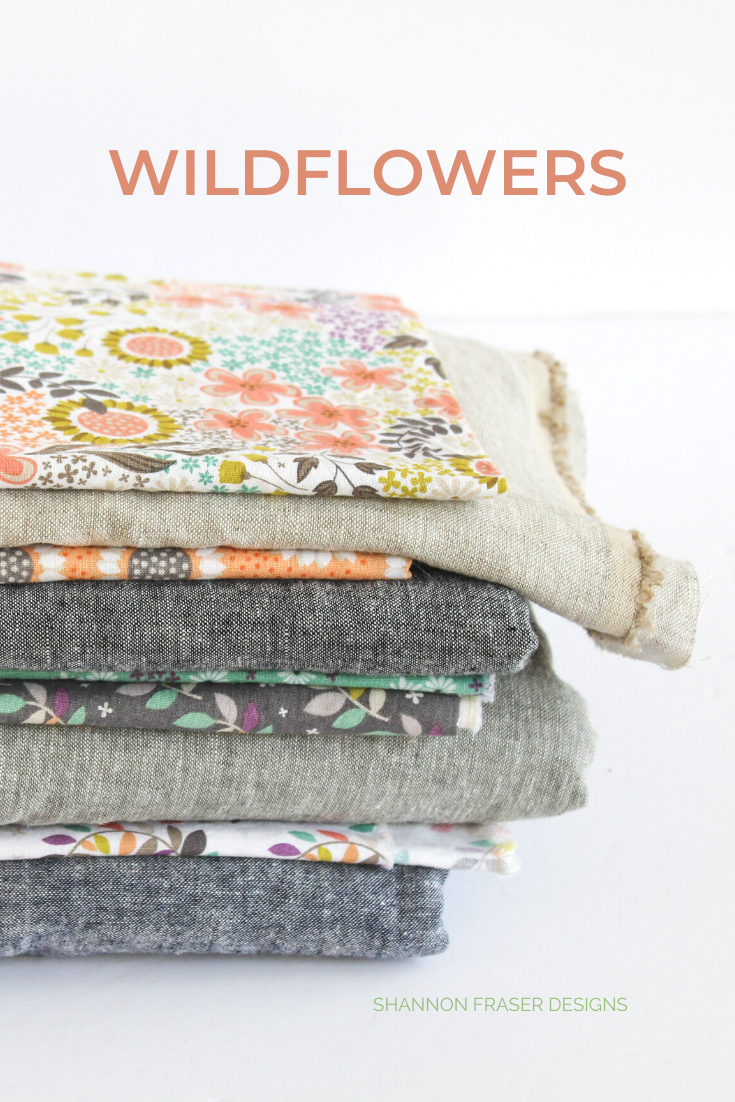 Stack of fabric featuring layers of linen + Wildflowers prints from Camelot Fabrics | Shannon Fraser Designs