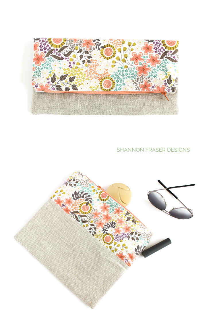Fold over clutch featuring Wildflowers fabric + linen with make-up spilling from top of open bag with sunglasses.