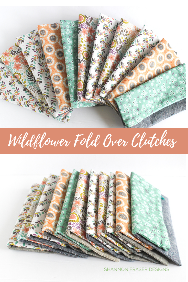 Stack of fold-over clutches fanned out and others overlapping on their sides | Shannon Fraser Designs