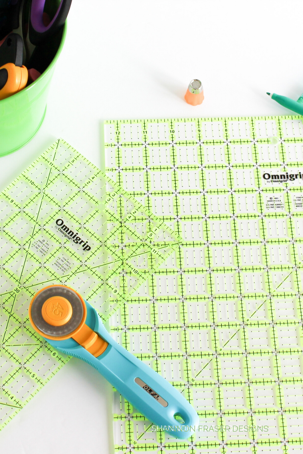 Olfa Splash rotary cutter on a pair of Omnigrid quilting rulers | Shattered Star QAL Week 2 Part 2: How to cut fabric | Shannon Fraser Designs #notions