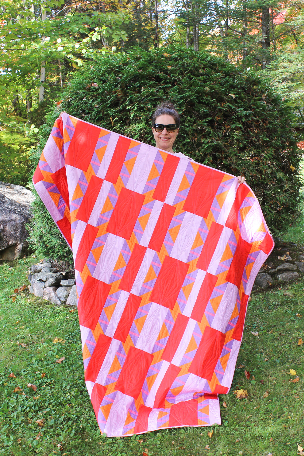 Me holding the Shattered Star quilt in the fall wild - features Ruby & Bee solids from Windham fabrics and uses the beginner friendly  Shattered Star quilt pattern by Shannon Fraser Designs #modernquilter