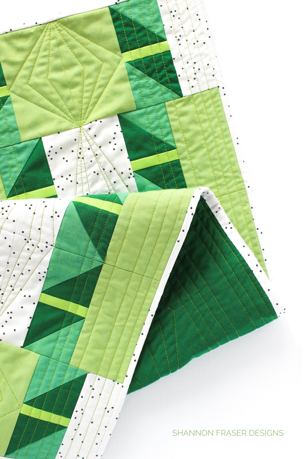 Shattered Star Table Runner - the Green Artisan Cotton one paired with 28wt Aurifil Thread for machine quilting | Shannon Fraser Designs #quiltedtablerunner