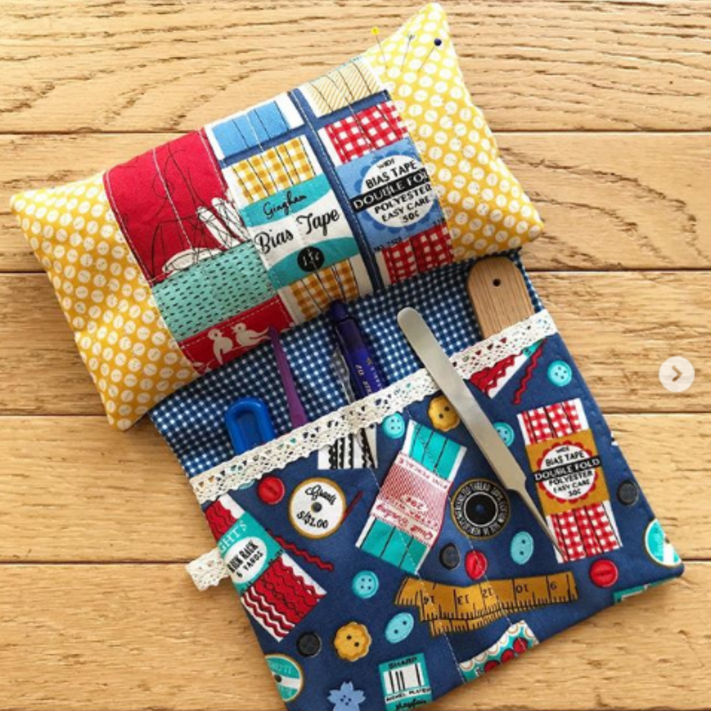 Sit 'n Sew Pincushion featuring sewing notions fabric print with hanging sleeve filled with actual sewing notions | Sit 'n Sew Pincushion Pattern | Shannon Fraser Designs