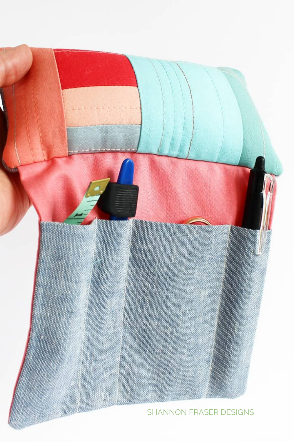 Close up of Sit 'n Sew pincushion showing off stored sewing notions in the pockets | Shannon Fraser Designs