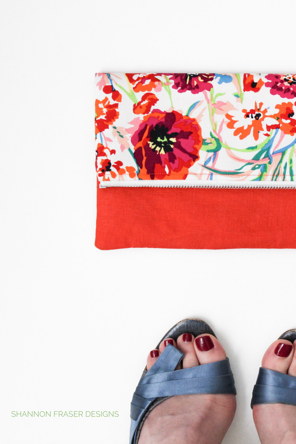 Fold-over linen floral clutch with coral linen and my feet in Nine West blue open toe heels with a satin bow | Shannon Fraser Designs
