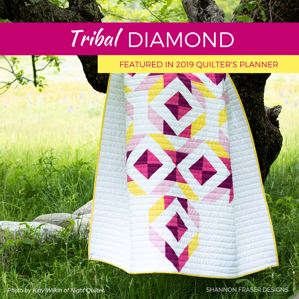 Tribal Diamond quilt hanging in a tree | Pattern featured in The Quilter's Planner 2019 | Shannon Fraser Designs