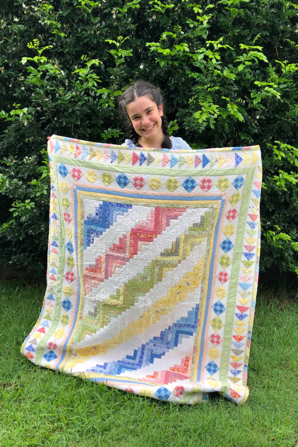 First quilt Xanthe made from Better Homes & Gardens and the quilt recipient holding her quilt up | What's in your sewing bag Wife-Made? | Shannon Fraser Designs' series #quiltsinthewild