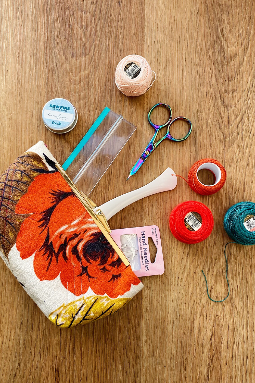 Lorna's gifted sewing bag with bold orange floral with scattered sewing and quilting notions falling out of the open bag | What's in Your Sewing Bag? Special Guest: Lorna from Cloth and Crescent | Shannon Fraser Designs