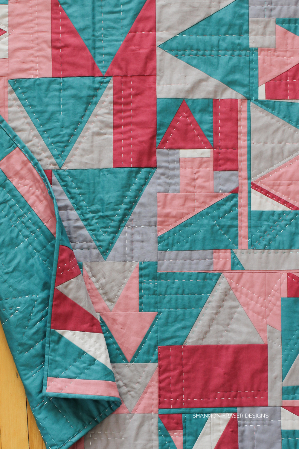 Which Way Up - modern improv quilt hand quilted by Shannon Fraser Designs featuring orphan blocks leftover from the Flight Plan quilt. Sustainable quilting + texture through hand stitching #modernimprovquilt