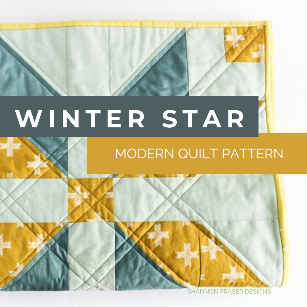 Winter Star Heartland version folded on the table | Modern Quilt pattern | Shannon Fraser Designs #starquilt