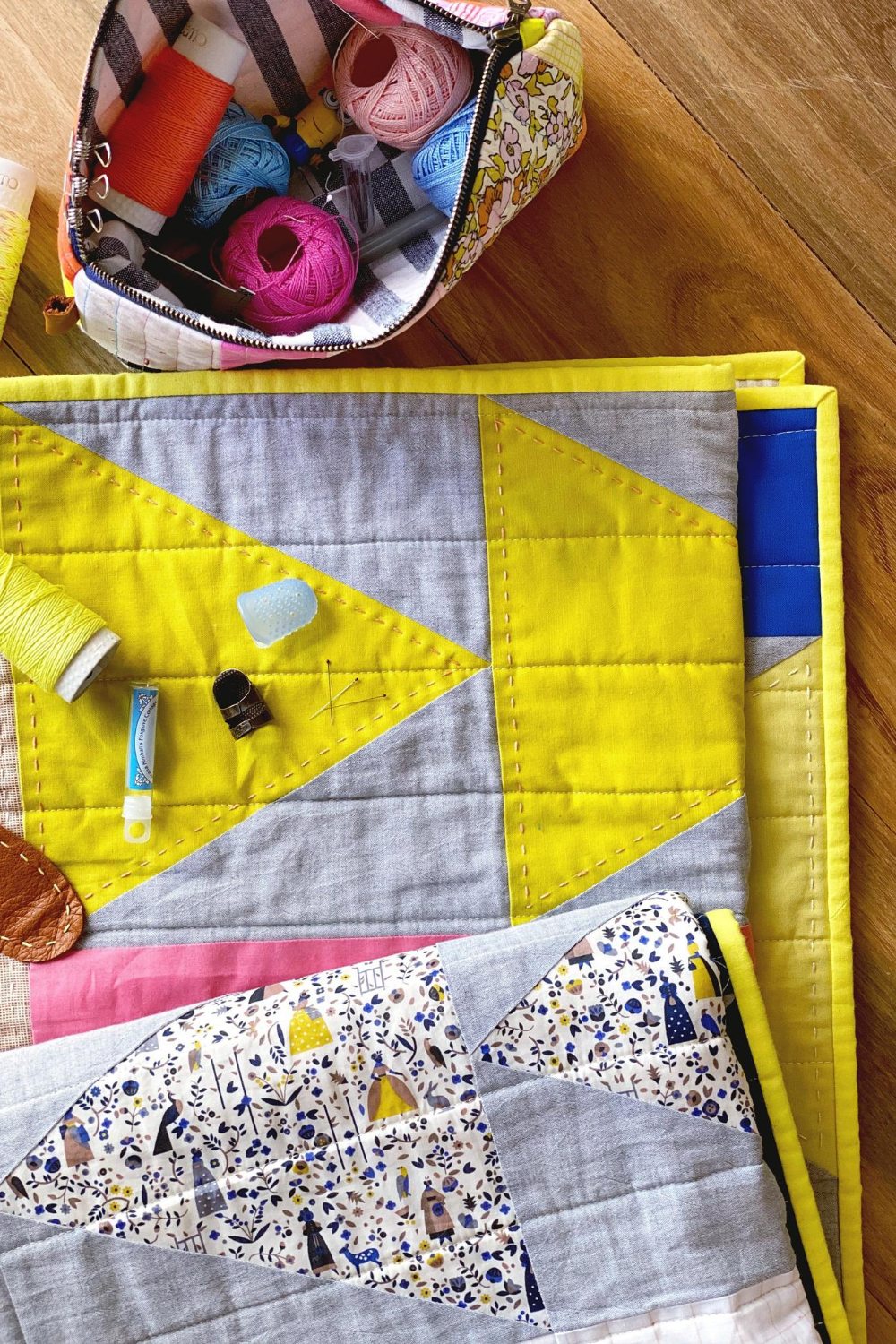 Yellow, gray and blue Flight Plan quilt hand quilted by Flip | What's in Your Sewing Bag Flip? | Shannon Fraser Designs #moderntrianglequilt