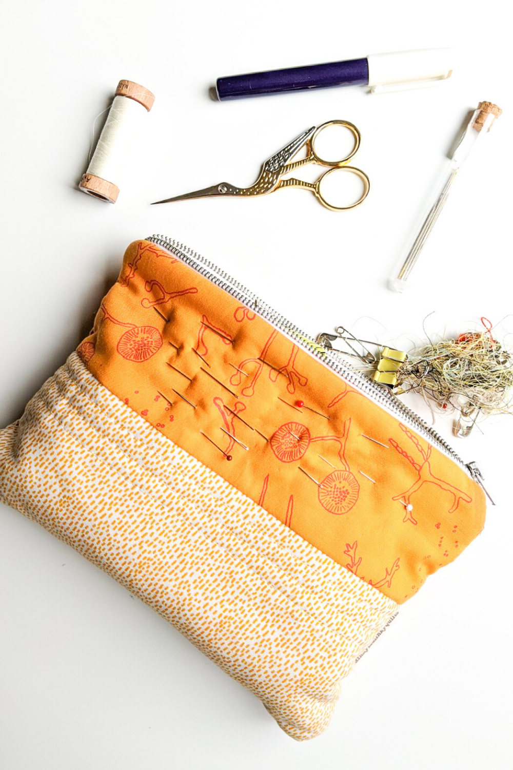 Yellow handmade zip pouch featuring custom printed fabric by Lucy Engels | What's in your sewing bag? | Shannon Fraser Designs