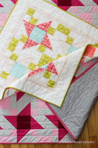 Irish Vortex Quilt Pattern (PDF) | Modern Star Quilt shown in Baby and Throw size