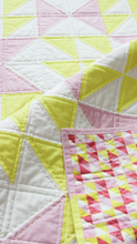 Load image into Gallery viewer, Pink Lemonade quilt pattern is an easy modern quilt pattern with 5 quilt sizes to choose from: baby , lap, double and queen. #modernnursery #quilting