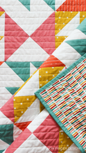 Load image into Gallery viewer, Mix up the fabric selection for a fun and colorful version of the Pink Lemonade Quilt Pattern.