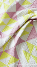 Load image into Gallery viewer, Modern and sweet baby girl quilt using the Pink Lemonade quilt pattern. Personalize your nursery décor with the beginner friendly quilt pattern.