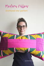 Load image into Gallery viewer, Shannon holding the Shattered star hand quilted lumber pillow | Shannon Fraser Designs #quilter
