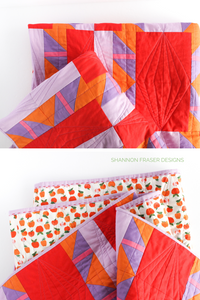 Quilting details on the Shattered Star lap quilt featuring Ruby & Bee solids in purple, orange, pink, red and lilac. Modern beginner friendly quilt pattern by Shannon Fraser Designs #quilt