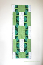 Load image into Gallery viewer, Shattered Star table runner pattern available in 3 sizes, shown here in medium featuring green ombré Artisan Cotton solids by Shannon Fraser Designs #quilt