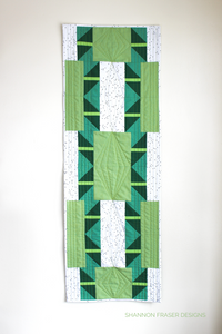 Shattered Star table runner pattern available in 3 sizes, shown here in medium featuring green ombré Artisan Cotton solids by Shannon Fraser Designs #quilt