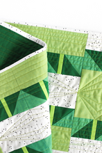 Load image into Gallery viewer, Quilting detail on the green ombré Shattered Star quilted table runner featuring 28wt Aurifil Thread | Beginner friendly modern quilt pattern | Shannon Fraser Designs #quilting