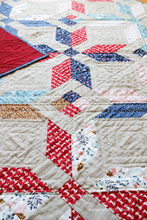 Load image into Gallery viewer, Close  up of hand quilting on the Winter Star quilt featuring Forest Talk fabric by Cathy Nordstrom paired with Essex Linen | Shannon Fraser Designs