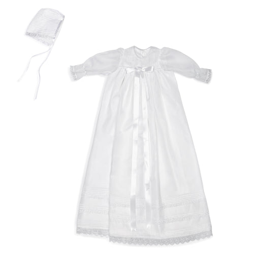 White organza baptismal and christening gown with lace and matching bonnet.