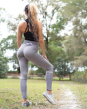 Women's Light Gray, Black and White Striped Butt Scrunch Leggings with a Booty Shaping Effect.