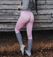 Women's Soft Pink and White Striped Butt Scrunch Leggings with a Booty Shaping Effect.