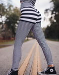 Women's Black and White Striped Butt Scrunch Leggings with a Booty Shaping Effect.