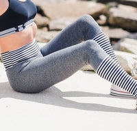 Women's Steel, Black and White Striped Butt Scrunch Leggings with a Booty Shaping Effect.