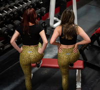 Women's Gold Stray Cat Butt Scrunch Leggings with a Booty Shaping Effect.