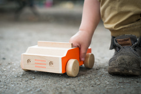 wooden toys pushing along the ground free outdoor open ended play