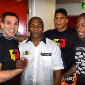 Boxing World Champion and legend Mike Tyson with Alistair Overeem, Rodney Glunder and Martijn de Jong during a MMA event in Manchester in the United Kingdom