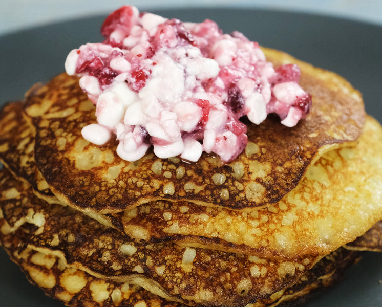 Potato Mini Pancakes in a Cast Iron Skillet with Cottage Cheese and Lingonberry