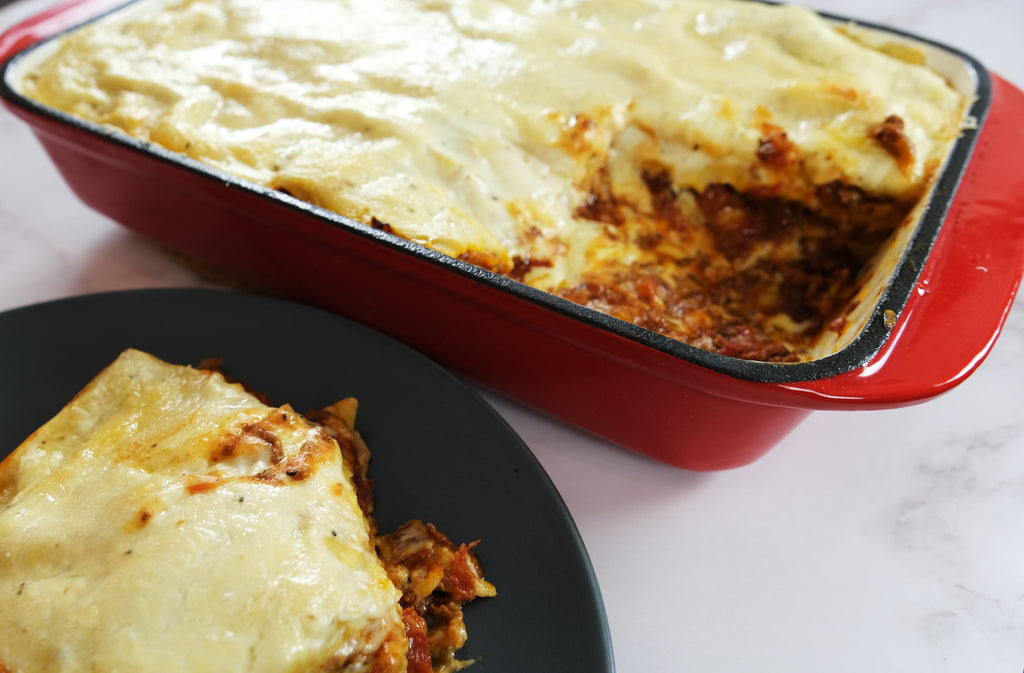 homemade lasagna in a enameled cast iron roasting pan