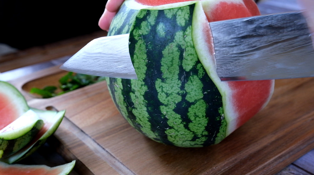 cutting melon from the side