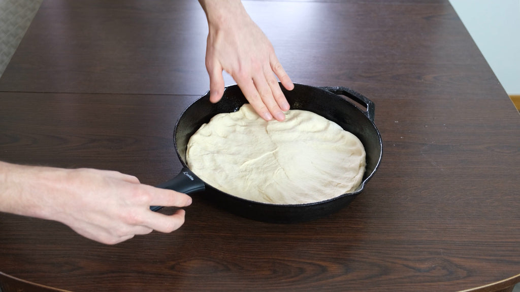 put the dough into the cast iron skillet pan