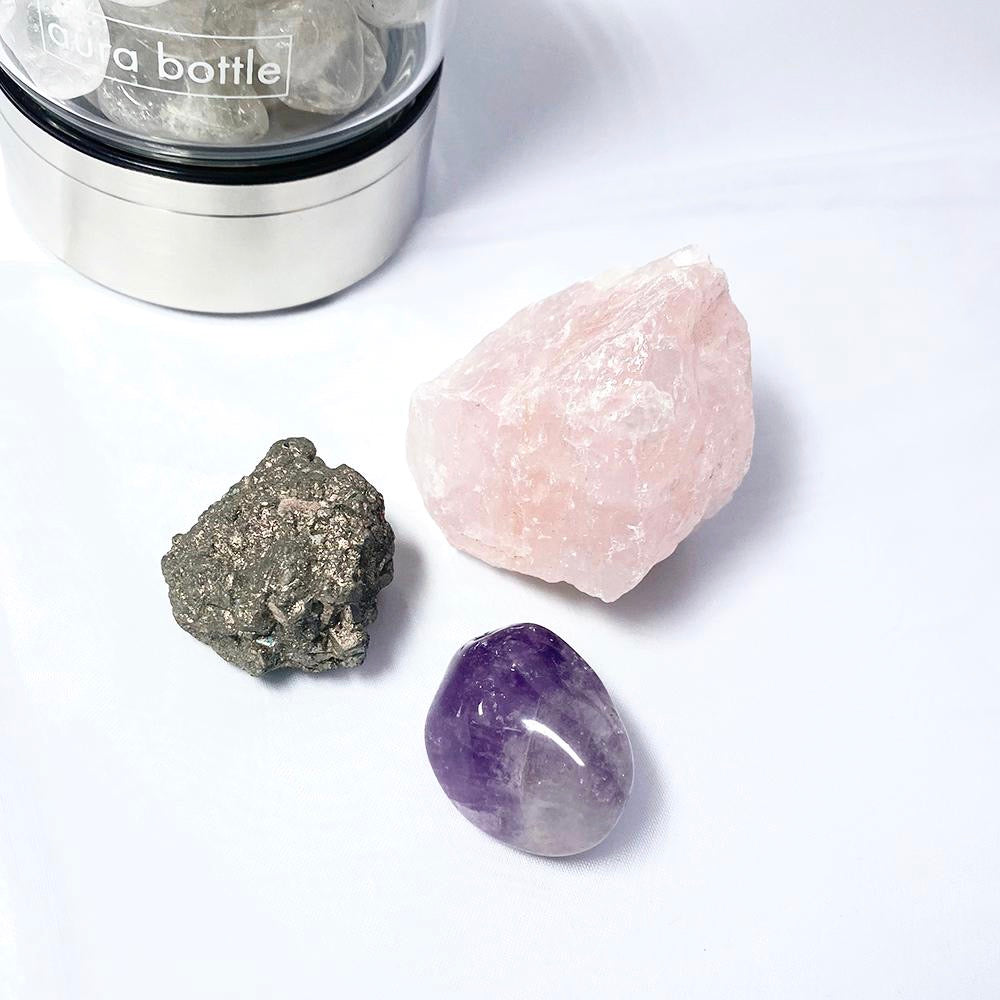Crystals for unconditional love, abundance + healing. This kit includes Rose Quartz, Pyrite, and Amethyst.