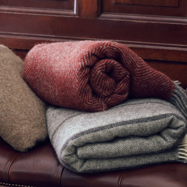 Gotland Dia Wool Blanket in red & grey | Home & Living inspiration | URBANARA