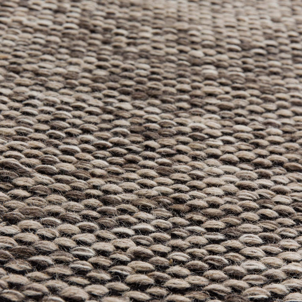 Odis rug in grey brown & off-white & black, 87% new wool & 9% cotton & 4% polyester |Find the perfect wool rugs